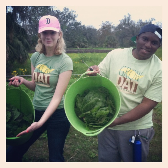Youth Crew Members Storie and Cory harvest greens to be sold at Saturdays markets across New Orleans